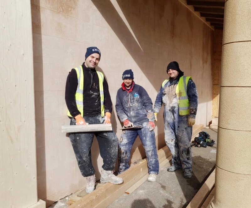 Holton Film Plastering team smiling to camera